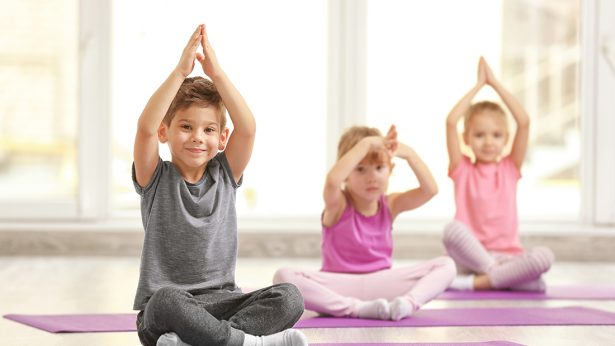 Group of children doing yoga
